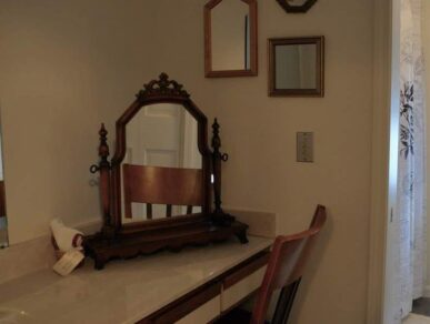 Image of the Rose Room Bathroom with Antique Mirror and Tub