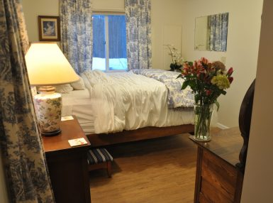 image of Cedar Room with a Queen Bed with blue and white linens